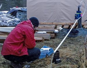 Terrasat engineer conducts water quality assessment at a remote site for mine permitting